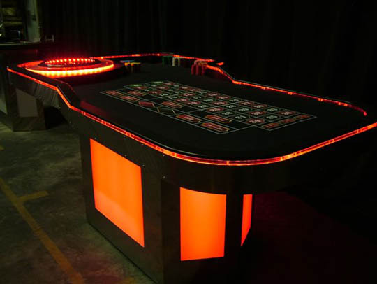 Red Lighted Roulette Table for Casino Parties